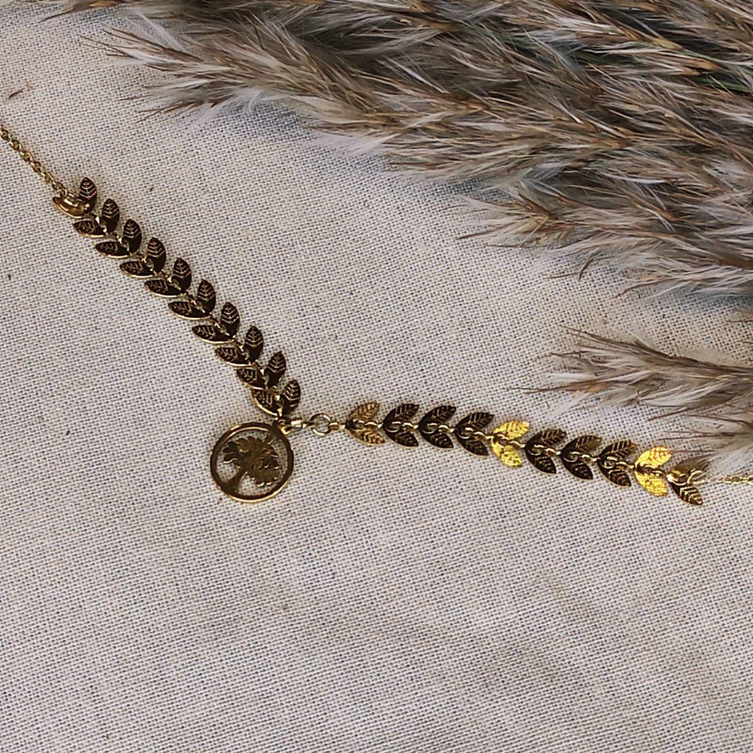 collier feuillage et arbred e vie doré en acier